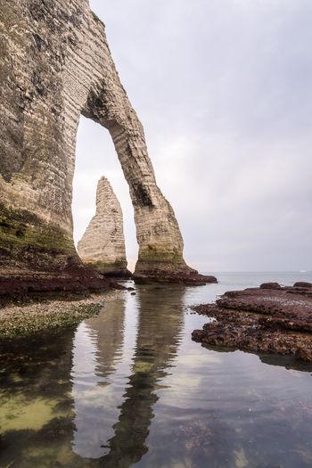 Natural Arch At Calm Sea