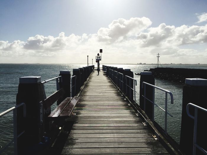 Walking down the pier Sea Horizon Over Water Water Sky Cloud - Sky Railing Pier Nature Day Beauty In Nature