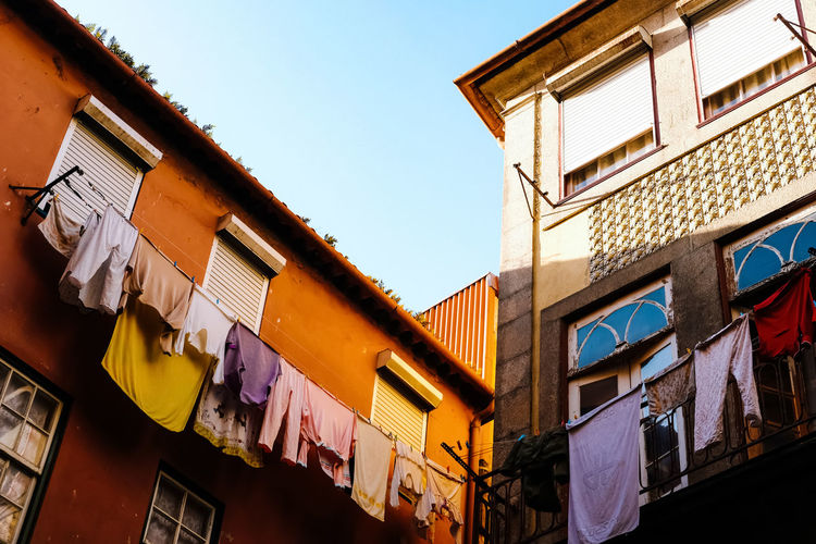 Building Exterior Built Structure Architecture Low Angle View Window Building Sky Residential District No People Day Nature Clothing Clear Sky City Outdoors Hanging Multi Colored Laundry House Drying