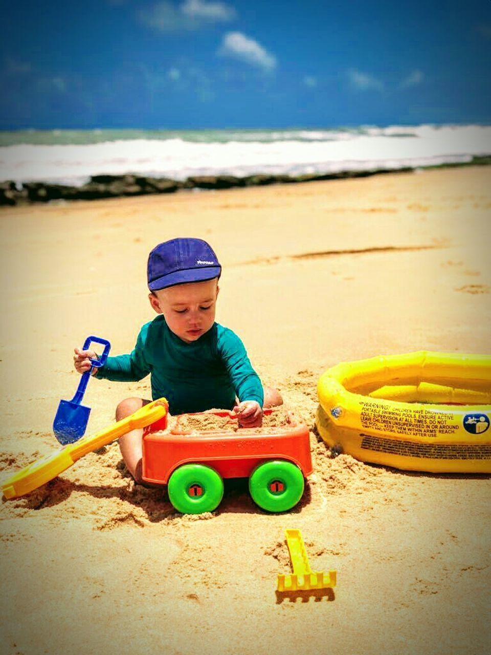 beach, sand, childhood, child, toy, sand pail and shovel, boys, one boy only, males, children only, one person, cute, playing, fun, full length, sea, summer, people, leisure activity, vacations, portrait, day, outdoors, water, sky