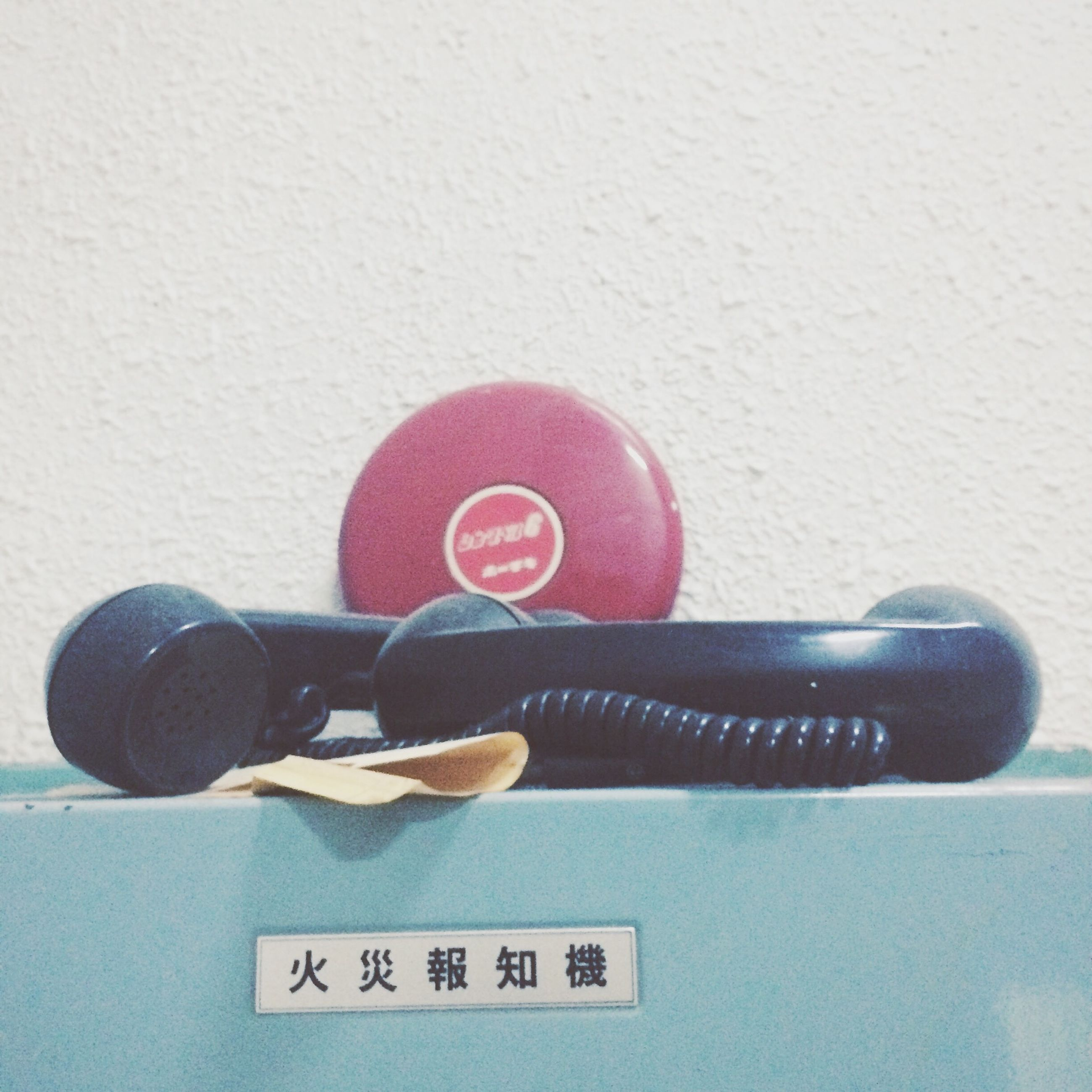 communication, text, red, indoors, western script, close-up, wall - building feature, number, still life, guidance, shoe, technology, high angle view, safety, sign, day, connection, no people, single object, footwear
