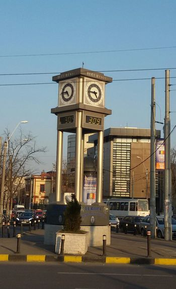 From My Point Of View Drivebyphotography Drive By Shooting Clock Clock Tower Cityclocks, Blue Skies City View  City City Street Urbanphotography Ontheroad Hello World Check This Out EyeEm Gallery EyeEm Best Shots EyeEmBestPics Popular Photos Urban Geometry Eyee4photography Beautiful Day