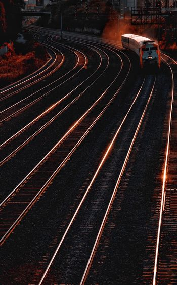 High angle view of railroad tracks at night