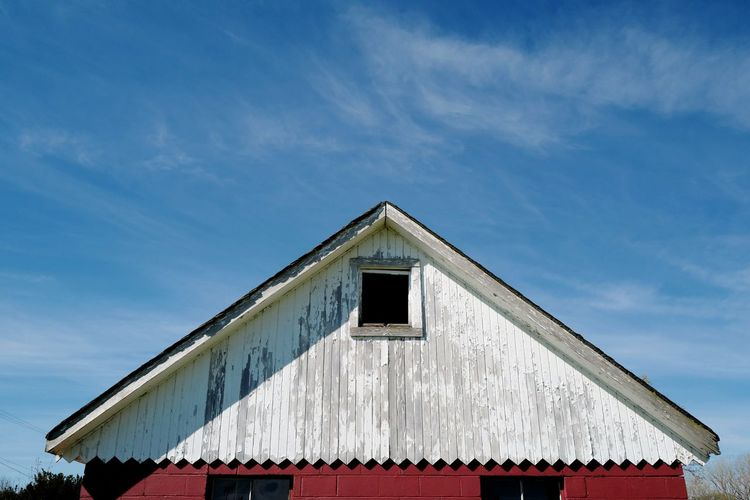 Old barn roof and blue sky
