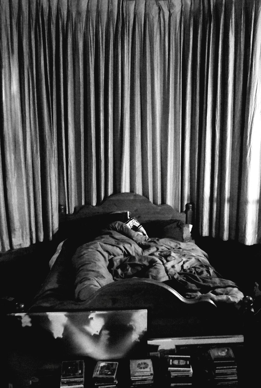 curtain, bed, indoors, bedroom, lying down, sleeping, one person, real people, drapes, night, mammal, people