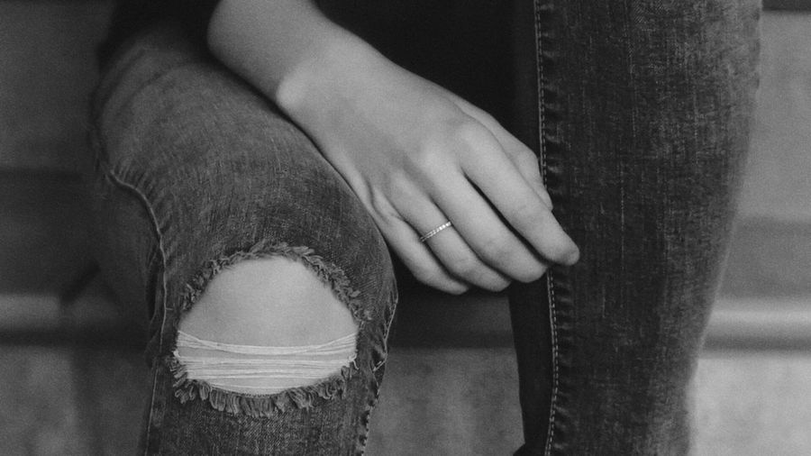 Midsection Of Woman With Torn Jeans
