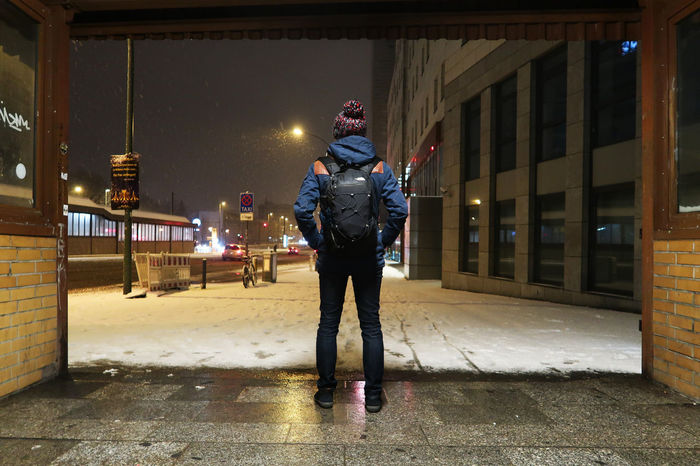 Young woman leaving the underground in the streets of wintertime Berlin. Architecture Built Structure City Life City Life In The Night Cold Illuminated Night One Animal One Person Outdoors Real People Snow Standing Urban Warm Clothing Winter Wintercoat Wintertime Young Woman
