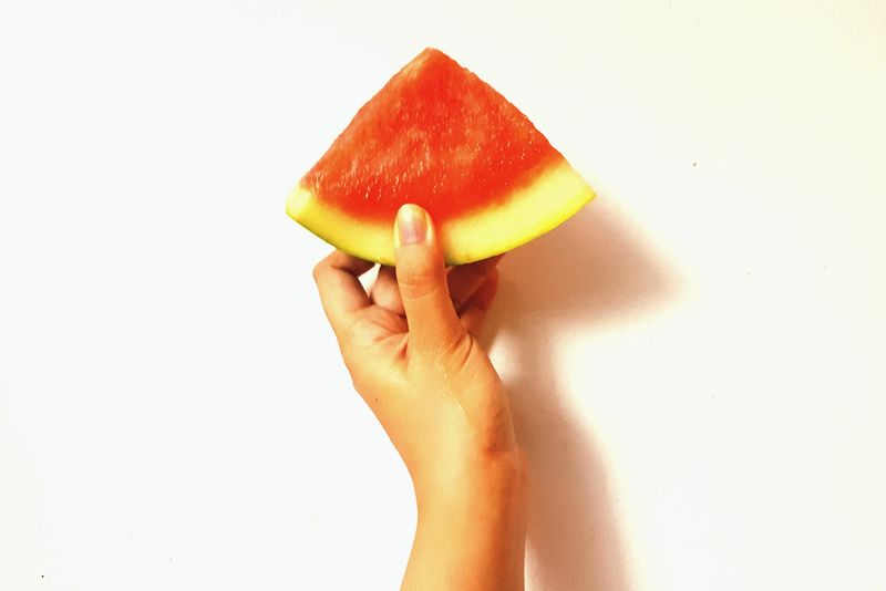 EyeEm Selects Healthy Eating Fruit Human Hand Watermelon Healthy Lifestyle Food And Drink Freshness SLICE Eating Food Lifestyles Red Indoors  Holding Human Body Part Still Life Juicy Juicy Fruit Fruit Photography Triangle Watermelon🍉 Sliced Fruit White Background Solid Background