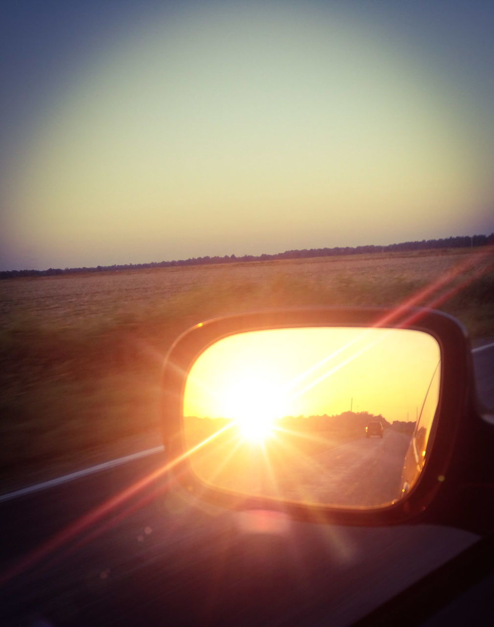 sun, sunset, sunlight, lens flare, sky, transportation, nature, side-view mirror, speed, beauty in nature, no people, car, scenics, clear sky, landscape, mode of transport, reflection, outdoors, motion, close-up, day