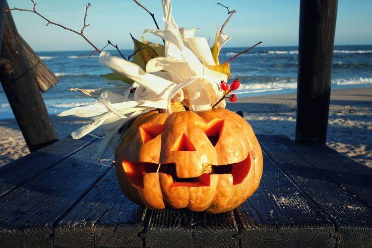 Jack o lantern on table at beach