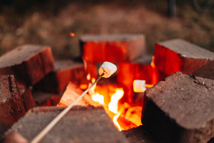 Close-up of burning  wood and marshmallows