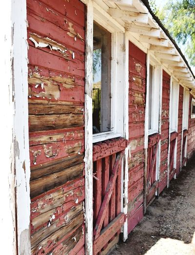 Empty Stalls with Stories to tell Abandoned Barn Stall Doors Architecture Building Exterior Wood - Material Weathered Red