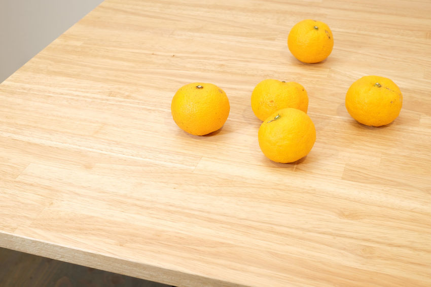 Citron, Japanese YUZU Fruit Citrus Fruit Healthy Eating Wellbeing Food Food And Drink Freshness Still Life Indoors  Close-up Orange Color Orange Orange - Fruit No People Yellow Citron Yuzu Table Wood - Material Cutting Board High Angle View Group Of Objects