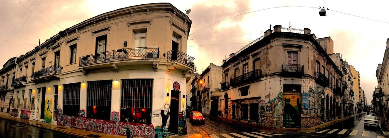 San Telmo Graffiti City Street City Life Panorama Panoramic Building Exterior Architecture Built Structure Street Sky Outdoors City Cloud - Sky Balcony No People Day Cars Buenos Aires Afternoon Distorted Perspective Colonial Architecture
