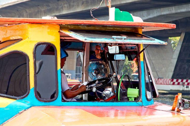 Portrait of people sitting in bus