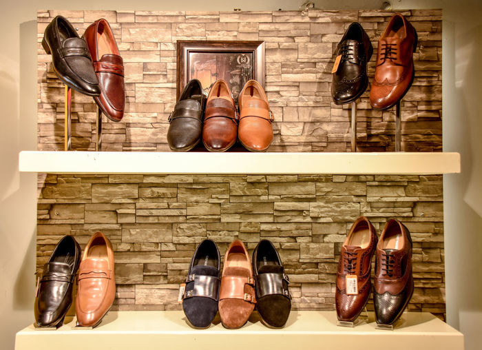 Close up of Shoe Shelf Lifestyle Shoes Market Best Brands Brand New Business Close-up Fashion For Sale Indoors  Large Group Of Objects Leather Shoes In Rack Luxury Shoes Mens Wear Pair Product Photography Retail  Shelf Shoe Shoemaker Shoes Collection Shoes Rack Shoes Store Store Variation Workshop