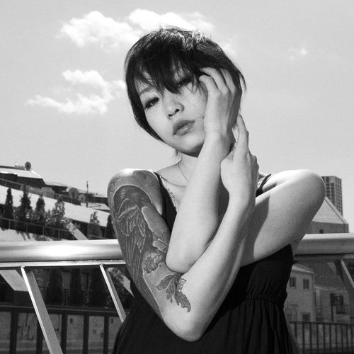 Female Model on bridge in Tokyo, Japan - Black&White. Cool Daikanyama Eye Contact Japan Tokyo Tokyo,Japan Woman Blackandwhite Clouds Crow Tattoo Day Girl Leisure Activity Lifestyles One Person Outdoors Real People Sky Tattoo Young Adult Young Women