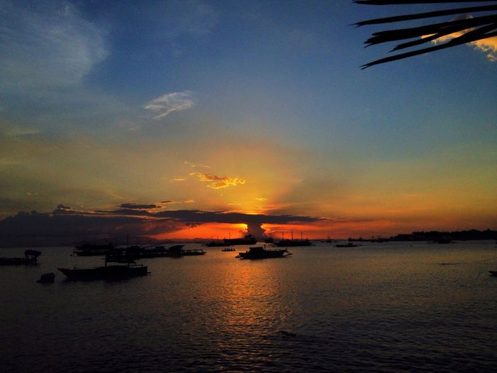 """Explosion V.1"" Sunset Beauty In Nature Sky Scenics Nature Water Sea Transportation Nautical Vessel No People Tranquil Scene Tranquility Silhouette Reflection Cloud - Sky Horizon Over Water Beauty In Nature EyeEm Best Shots EyeEm Nature Lover EyeemPhilippines JASAAN, MIS.OR Be. Ready."
