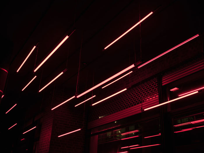 Architecture Dark Illuminated Low Angle View Night Lighting Equipment No People Red Built Structure Glowing Light Electricity  Light - Natural Phenomenon Electric Light Neon Nightlife In A Row Abstract Digital Neon Lights Dark Outdoors Lines Marketing Urban Repetition Urban Scene Street Light Entertainment Lamp