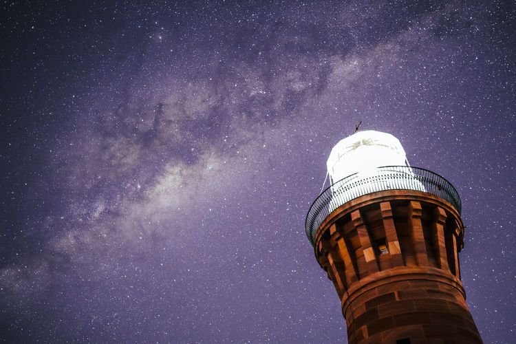 Low angle view of tower against sky at night