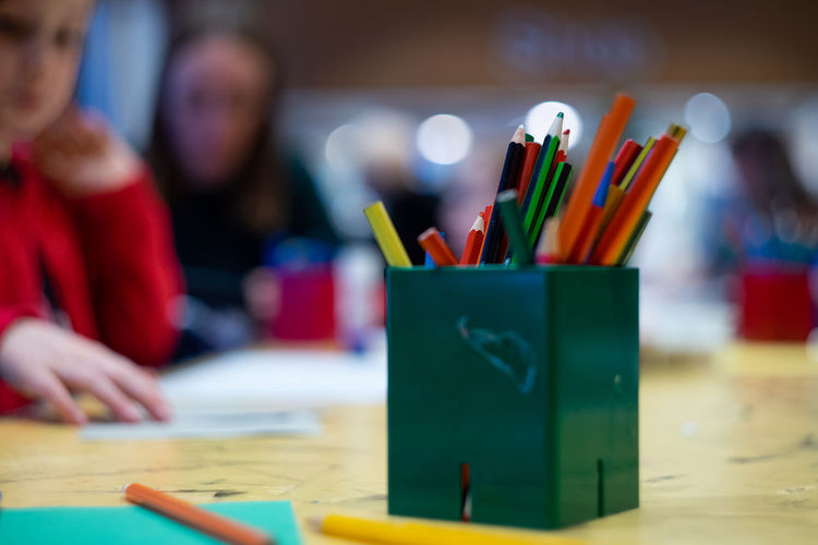 Indoors  Table Creativity Art And Craft Pencil Education Focus On Foreground Incidental People People Selective Focus Child Craft Learning Art And Craft Equipment Paint Real People Multi Colored Childhood Coloring Pencils