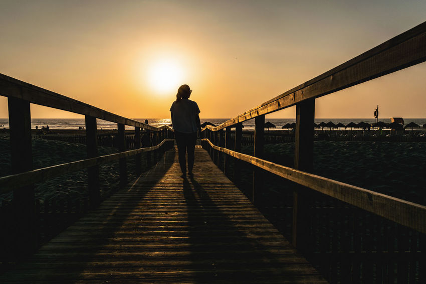 Architecture Bridge Bridge - Man Made Structure Built Structure Connection Leisure Activity Lifestyles Nature One Person Orange Color Outdoors Railing Real People Sky Standing Sunset The Way Forward Water A New Beginning Capture Tomorrow