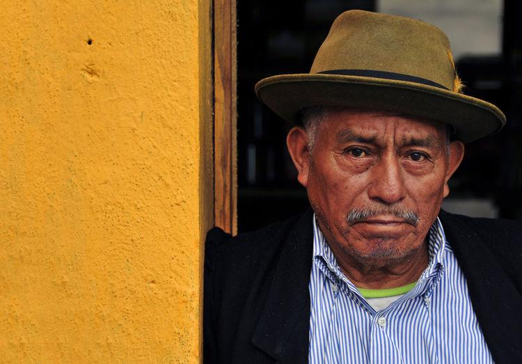 Vendor on the street in Panajachel, Guatemala Guatemala Adult Clothing Contemplation Day Front View Hat Headshot Lifestyles Looking At Camera Males  Mature Men Men One Person Panajachel  Portrait Real People Senior Adult Senior Men Vendor Wrinkled