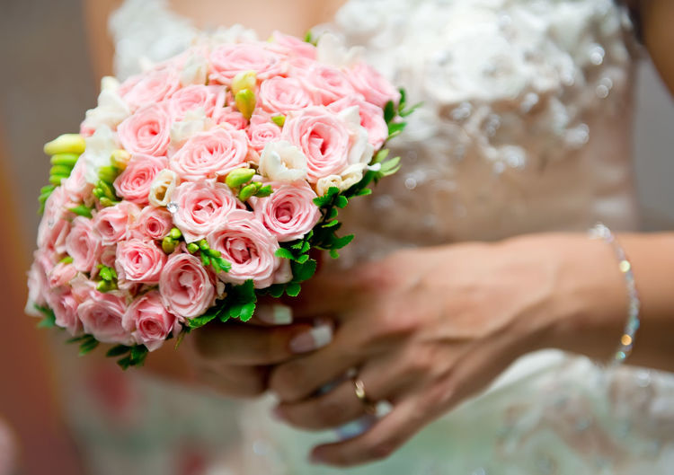 Beautiful bridal bouquet close-up Adult Beauty Beauty In Nature Bouquet Bride Bunch Of Flowers Bunch Of Roses Celebration Event Ceremony Close-up Day Female Flower Flower Arrangement Hands Holding Life Events Love Pink Color Rose - Flower Wedding Wedding Ceremony Wedding Dress Women