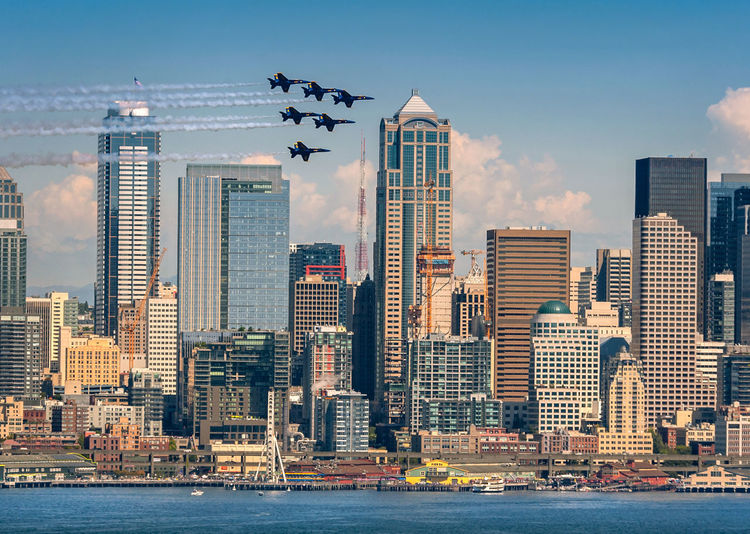 Blue Angels in Seattle! The Blue Angels are in Seattle for Seafair-an all city celebration with hydroplane races, air shows and downtown parades. Blue Angels Celebration FA/18 Hornet Formation Seafair Seattle Air Show Architecture Building Building Exterior City Cityscape Cloud - Sky Diamond Flying Landscape Modern No People Office Building Exterior Sky Skyscraper Travel Destinations Urban Skyline Water Waterfront