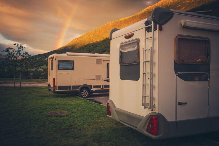 Camper Van On Field Against Sky During Sunset