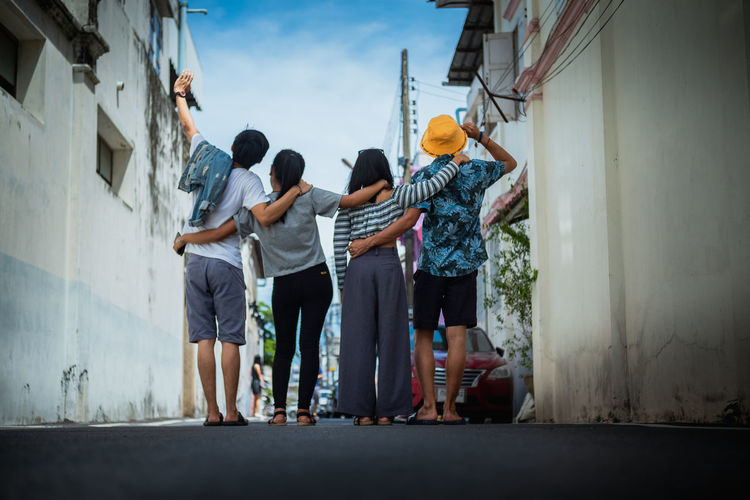 Friend and Family. Group Of People Friendship Men Hat People Built Structure City Standing Teenager Casual Clothing Cooperation Day Young Adult Full Length EyeEmNewHere