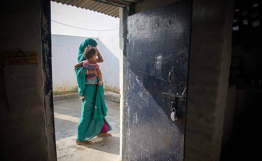Walking ahead Mother Child Carrying Babyinarms Framed Door Green Sari Walking One Woman Only Full Length Outdoors Woman