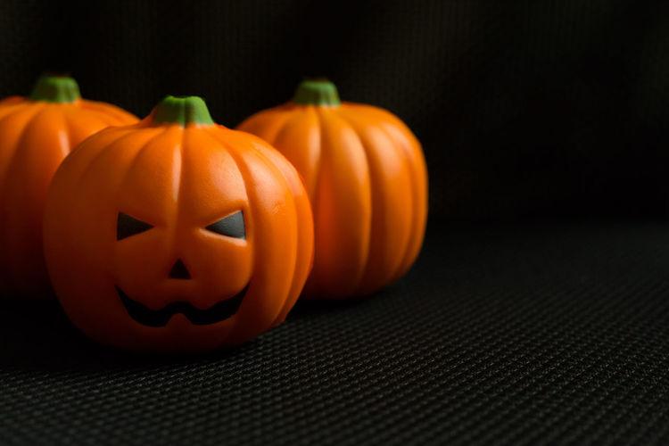 Close-up of pumpkin on black background