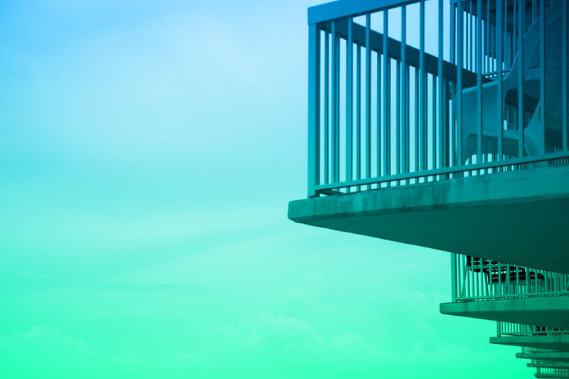 A Bird's Eye View Architecture Balcony Blue Building Story Built Structure Clear Sky Copy Space Day Development Engineering Gradient High Section Low Angel View Low Angle View Modern No People Outdoors Sky