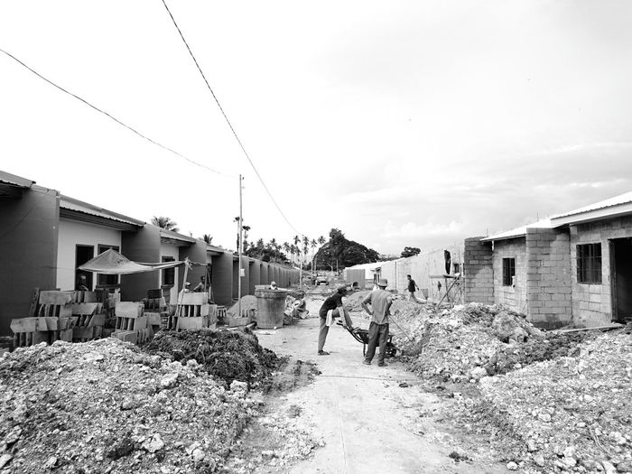 Constructing. . Architecture Monochrome Photography Built Structure House Residential Building Sky Residential Structure Day City Life Cloudy Outdoors SONYXPERIAX Xperiax EyeEmBestPics Sonyxperia Work EyeEm Best Edits Eyeem Philippines EyeemPhotos EyeEm Gallery Eyeemphoto EyeEm Best Shots - The Streets Street Fashion Streetphotography Week Of Eyeem