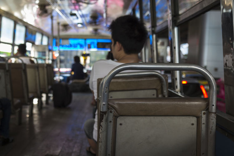 blur scene of inside omnibus in Bangkok, Thailand Bangkok Blur Background City City Life Day Focus On Foreground In The Bus Lifestyles Mode Of Transport Omnibus On The Move On The Road On The Way Selective Focus Snapshot