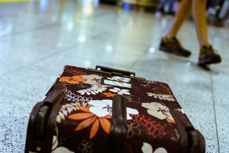Travel Travel Destinations Airport Trip Journey Holiday Indoors  Close-up Table No People Flooring Focus On Foreground High Angle View Tile Tiled Floor Still Life Orange Color Day Selective Focus Chocolate Pattern Celebration Floral Pattern Suitcase A New Perspective On Life It's About The Journey