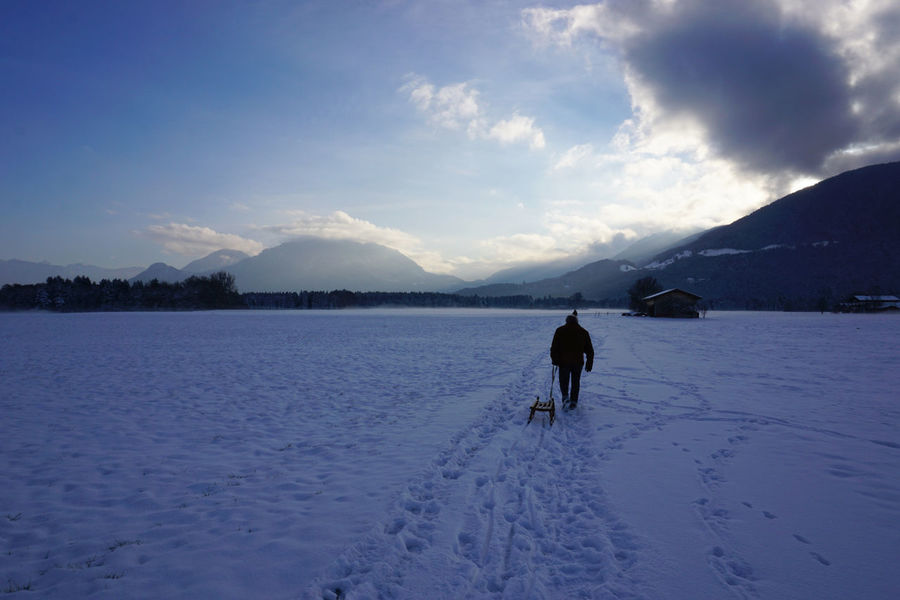 Way home Beauty In Nature Cloud - Sky Cold Temperature Day Landscape Mountain Mountain Range Nature One Person Outdoors People Schlitten Sky Sleigh Snow Snow ❄ Winter Winter Winterwalk Shades Of Winter