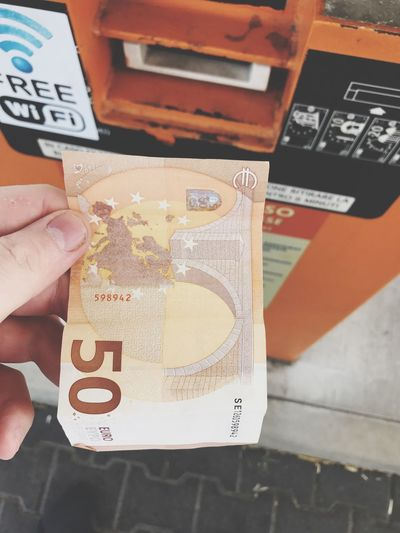 Atm Fuel Pump 50 Money Euro Human Hand Human Body Part Hand One Person Real People Holding Communication Lifestyles Unrecognizable Person Close-up Body Part Text Leisure Activity Number Mode Of Transportation Transportation Technology High Angle View Indoors  Finger