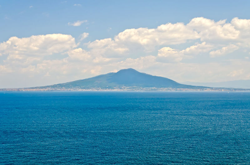 View of the iconic volcano Vesuvius from Sorrento Town in the Bay of Naples, Italy Beauty In Nature Blue Cloud - Sky Day Horizon Idyllic Land Nature No People Non-urban Scene Outdoors Remote Scenics - Nature Sea Sky Tranquil Scene Tranquility Turquoise Colored Water Waterfront