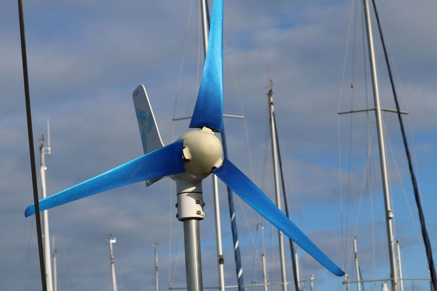 WindGenerator Alternative Energy Blue Cloud - Sky Day Environmental Conservation Fuel And Power Generation Low Angle View Mast Mode Of Transportation Nature No People Outdoors Pole Renewable Energy Sailboat Sky Steel Transportation Turbine Wind Power Wind Turbine