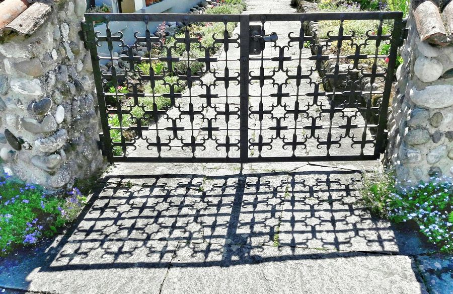 Einmal in Farbe.. Wrought Iron Gate Wrought Iron Garden Door Shadows & Light Shadows Outdoors No People Bnw Photography Bnw Bnwmood Garden Architecture Architecture Patterns Patterns Everywhere Pattern Photography Day Close Up Stonewalls Built Structure Focus On Shadow