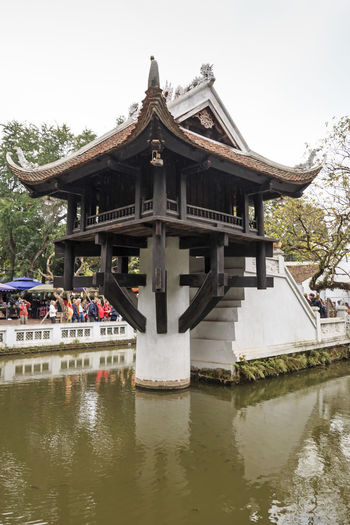 Hanoi, Vietnam - February 23, 2016: Tourists visiting the One Pillar Pagoda of Hanoi in Vietnam Architecture Built Structure Culture Day Façade Gazebo Hanoi Hanoi Vietnam  Ho Chi Minh Mausoleum No People Old Town One Pillar Pagoda Outdoors Place Of Worship Religion Sky Spirituality Temple Temple - Building Tourism Tourists Travel Destinations Tree Vietnam Water