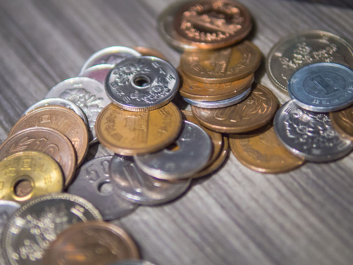 Close-up of japanese coins on table