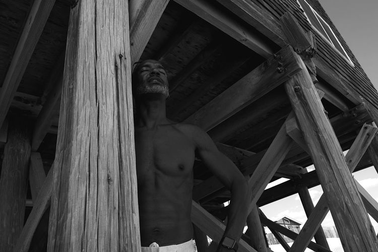 Rejuvenation Me Enjoying Life Day Built Structure Low Angle View Human Representation Wood - Material One Person Adult Men Photographyisthemuse Fujifilm_xseries Shirtless Leisure Activity Travel Black And White Beach Life Fire Island