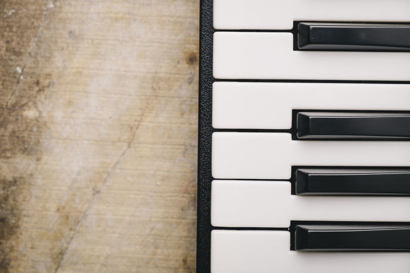 Keyboard synthesizer Black Buttons Close-up Composer Directly Above Electro Indoors  Instrument Key Keyboard Instrument Man Music No People Note Piano Player Playing Song Songwriter Synthesizer Technology White Wood - Material