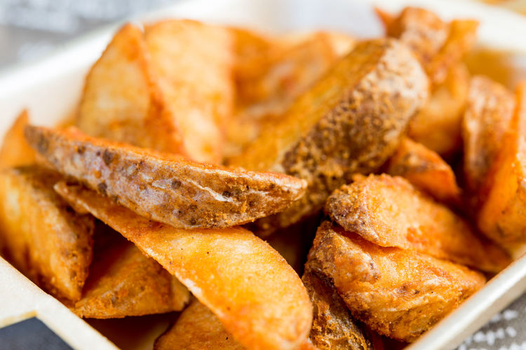 Close-Up Of Fried Potatoes In Bowl