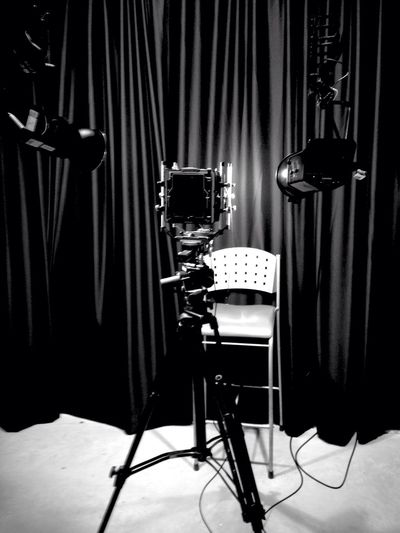 Light Falling On Empty Chair In Photo Studio