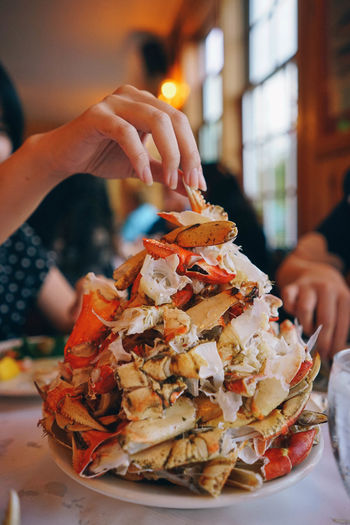 Crab Tower Food And Drink Human Hand Food Hand One Person Real People Holding Freshness Human Body Part Focus On Foreground Lifestyles Ready-to-eat Indoors  Leisure Activity Close-up Unhealthy Eating Unrecognizable Person Plate Women Finger Temptation Crab - Seafood