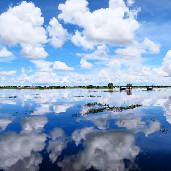 Lake Lake View Floating Village Tonlesap Tonle Sap Lake Cambodia Cambodian Reflection Water Sky Cloud - Sky Nature Scenics No People Beauty In Nature Tranquil Scene Tranquility Outdoors Waterfront Day Tree Travel Photography Miles Away Travelling